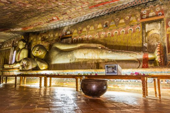 A statue of reclining Buddha in Dambulla Cave Temple