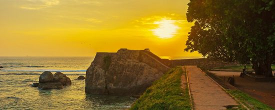 The sunset sky over the Flagrock Bastion, romantic place for the evening walks along the ramparts, Galle, Sri Lanka.